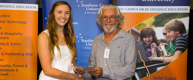 Emma Bowden and Peter Bowen, at Southern Cross University receiving her NRCF SCU Bowen Scholarship from Peter Bowen in March 2012