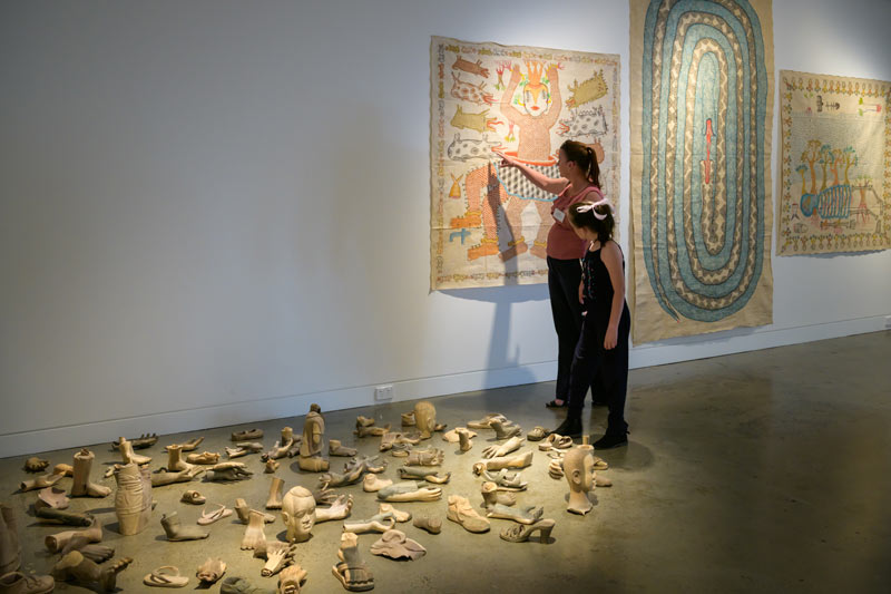 Tania Kirkland and her daughter Emily from Little Wings enjoying  > the exhibition at Lismore Regional Gallery
