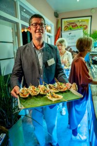 Board Director David McGrath serving delicious treats from One Green Acre